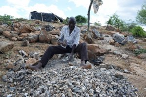 The Water Project:  Breaking Up Stones