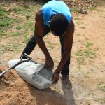 The Water Project: Mwau Community -  Mixing Cement