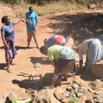 The Water Project: Kathungutu Community -  Gathering Rocks