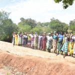 The Water Project: Kathungutu Community -  Standing On The Completed Dam