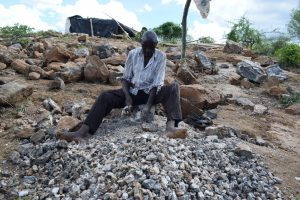 The Water Project:  Breaking Up Stone