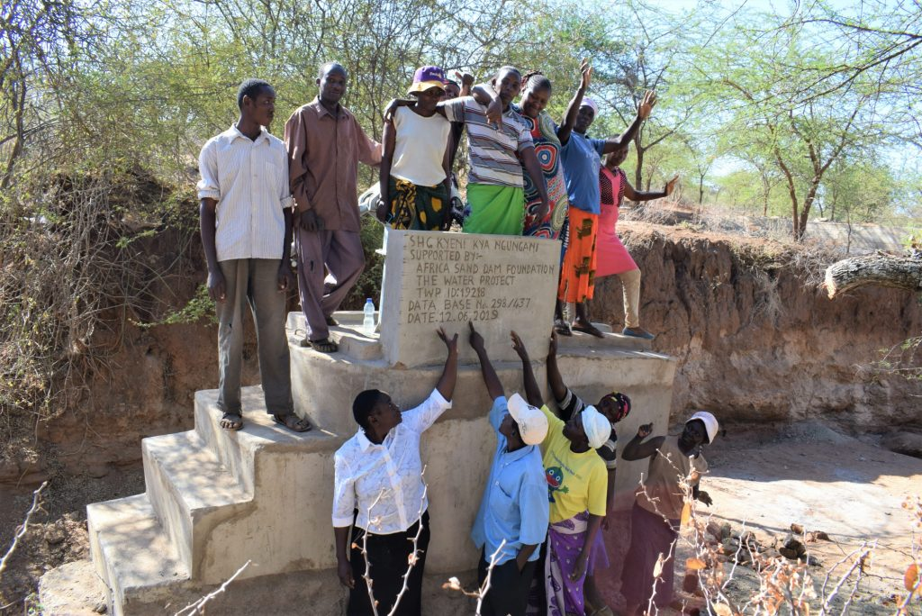 The Water Project : kenya19218-high-fives-for-the-new-well