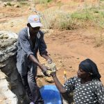 The Water Project: Mwau Community A -  Handing Over Stone For Well