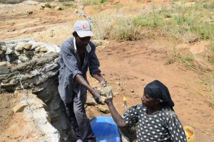 The Water Project:  Handing Over Stone For Well
