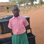 The Water Project: Kituluni Primary School -  Student Poses With Handwashing Station