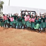 The Water Project: Kituluni Primary School -  Students Celebrate In Front Of Tank