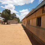 The Water Project: Kakunike Primary School -  School Grounds With New Tank Drying