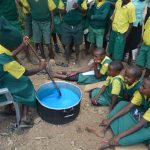 The Water Project: Kakunike Primary School -  Student Making Soap