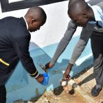 The Water Project: Kalulini Boys' Secondary School -  Collecting Water