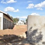 The Water Project: Kalulini Boys' Secondary School -  Curing Tank And School Building