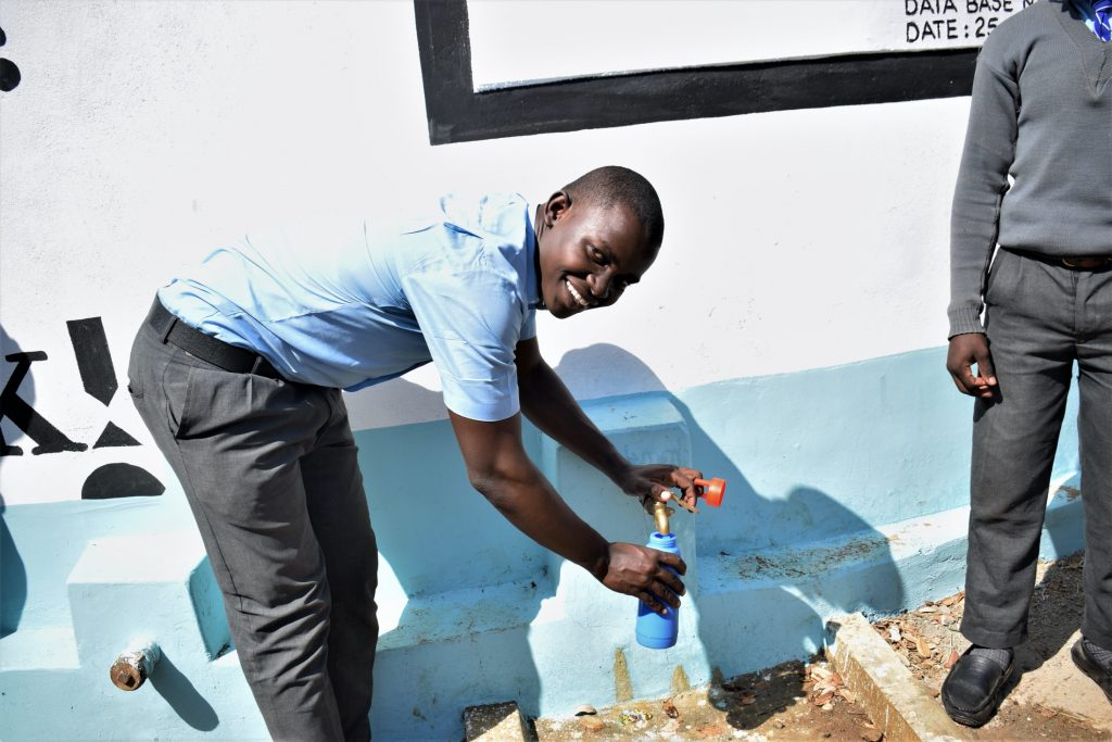 The Water Project : kenya19239-smiles-for-water-from-the-tank
