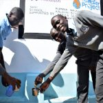 The Water Project: Kalulini Boys' Secondary School -  Students Collect Water