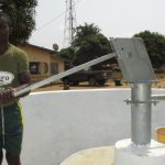 The Water Project: Tholmossor, Amputee Camp -  Pumping Water After Installation