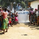 The Water Project: Tholmossor, Amputee Camp -  The Counselor Celebrating With Community Members