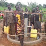 The Water Project: Kimigi Kyamatama Community -  Fetching Water At The Well
