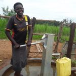 The Water Project: Kimigi Kyamatama Community -  Jane Fetching Water