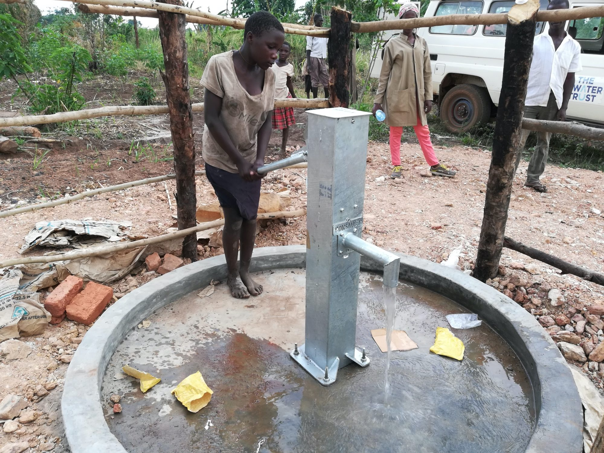 The Water Project : uganda19281-pumping-the-well