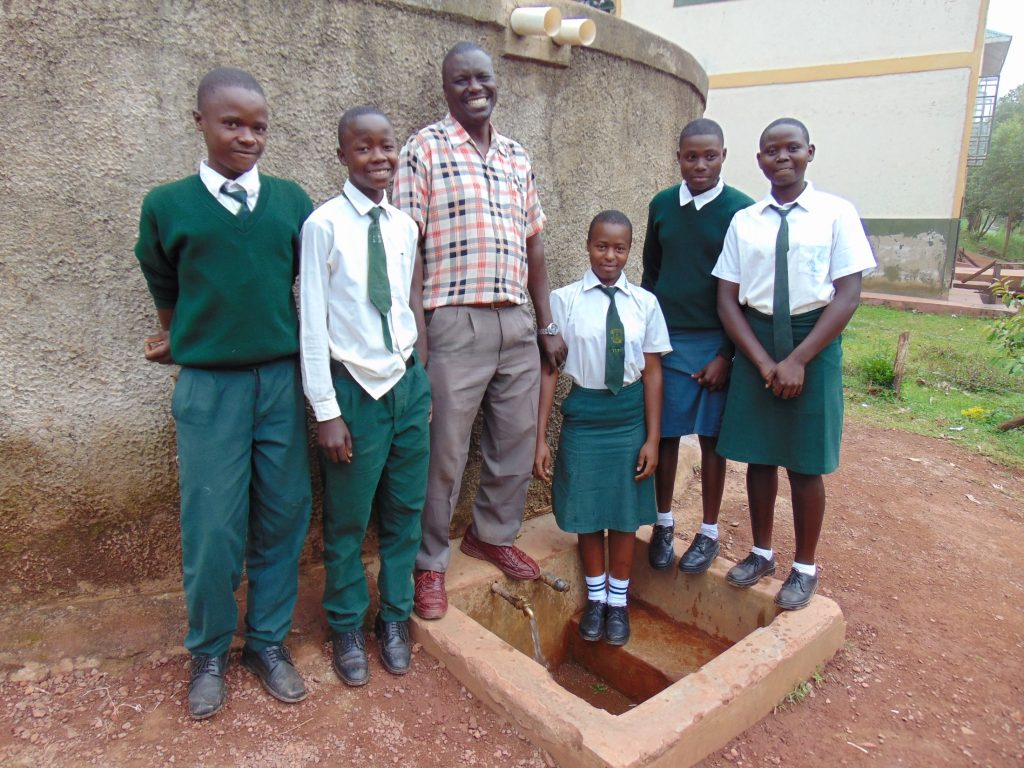 The Water Project : 0-kenya18036-students-and-mr-muchesia-at-rain-tank