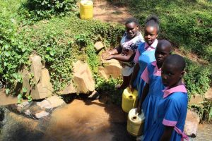 The Water Project:  Team Leader Catherine Chepkemoi With Students At The Stream