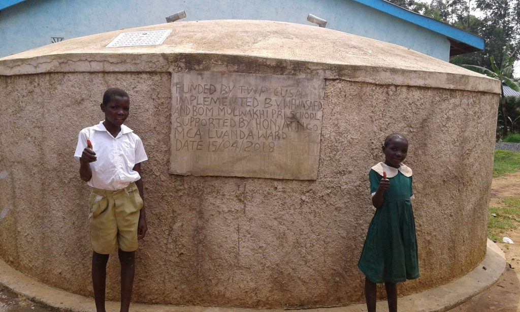 The Water Project : 1-kenya18015-posing-with-the-tank
