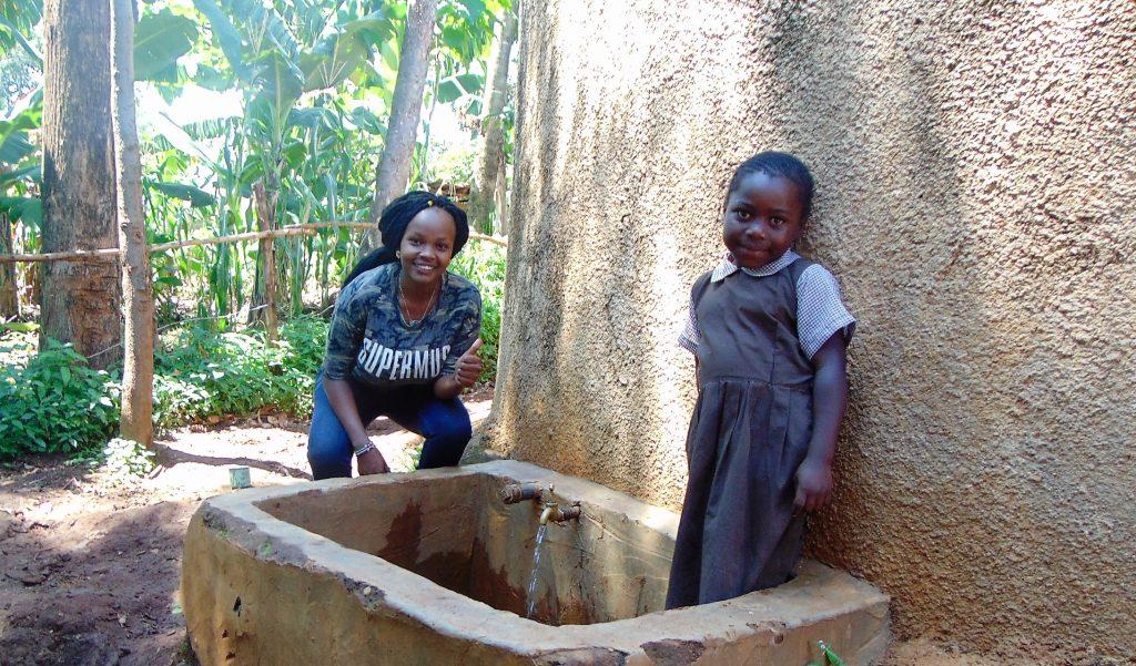 The Water Project : 1-kenya18018-field-officer-georgina-with-noeline