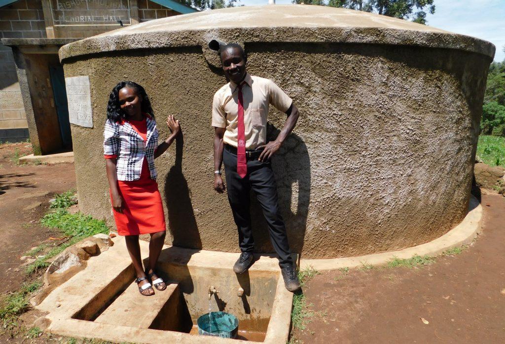 The Water Project : 1-kenya18023-teacher-mrs-gloria-tsindoria-and-student-calvar-alionya
