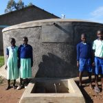 The Water Project: Musabale Primary School -  Students At The Rain Tank
