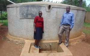 The Water Project:  Field Officer Janet Kayi With Head Teacher Mr Patrick Mango