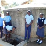 The Water Project: Muyere Secondary School -  Students At Rain Tank