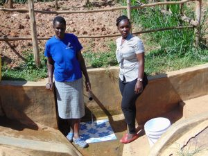 The Water Project:  Field Officer Laura Alulu Right With Community Member