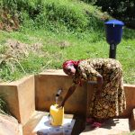 The Water Project: Jivovoli Community, Gideon Asonga Spring -  Gladice Fetches Water