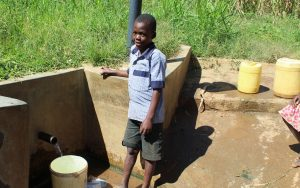 The Water Project:  Boy At Spring