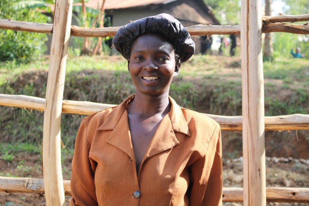 The Water Project : 1-kenya18284-mrs-christine-nyapola-well-caretaker