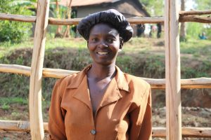 The Water Project:  Mrs Christine Nyapola Well Caretaker
