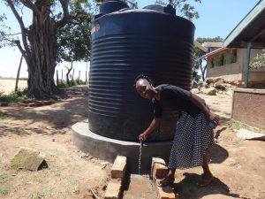 The Water Project:  Teacher With Five Thousand Liter Tank