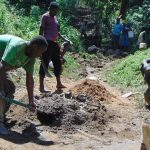 The Water Project: Shamiloli Community, Kwasasala Spring -  Mixing Cement