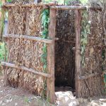 The Water Project: Kimaran Community, Kipsiro Spring -  Bathroom Made Of Banana Leaves