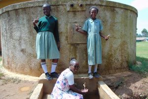 The Water Project:  Students And Field Officer Joan Were