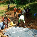 The Water Project: Mutao Community, Kenya Spring -  Adding In The Plastic Tarp