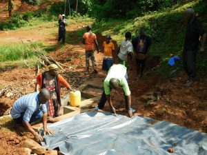 The Water Project:  Adding In The Plastic Tarp