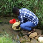 The Water Project: Kalenda B Community, Lumbasi Spring -  Fetching Water
