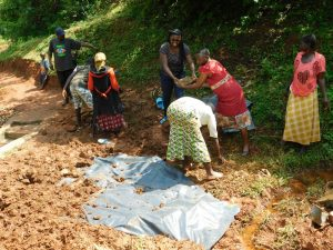 The Water Project:  Women Helping Out At The Spring