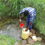 The Water Project: Kalenda B Community, Lumbasi Spring -  Filling Up