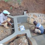 The Water Project: Buhayi Community, Nasichundukha Spring -  Helping Lay The Tiles