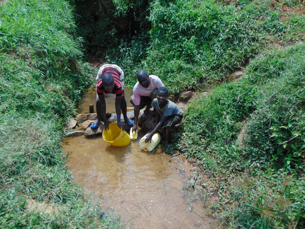 The Water Project : 11-kenya19153-collecting-water-at-the-spring