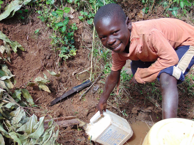 The Water Project : 11-kenya19168-filling-up-at-kipsiro-spring