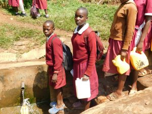 The Water Project:  Students Line Up To Fetch Water At The Spring
