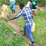 The Water Project: Kalenda B Community, Lumbasi Spring -  Carrying Water Home