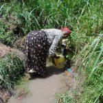 The Water Project: Bukhaywa Community, Shidero Spring -  Beatrice Fills Up