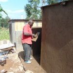 The Water Project: Kapchorwa Primary School -  Cementing Latrine Walls